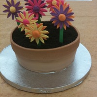 "My Daughters Flowerpot Cake   Yellow cake with Amaretto mousse filling. Pot and flowers are fondant. The ""dirt"" is oreos."