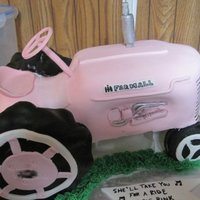 Pink Tractor Cake A carved cake with RKT tires all covered in fondant. Propped with a glad container underneath. She owns a Farmall tractor and has always...