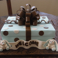 Blue And Brown Bunny Present White cake with buttercream and strawberry jam filling. Fondant and gumpaste decorations. What do you think? My 1st attempt at a gift box,...