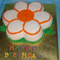 Daisy Cake Vanilla cake decorated with buttercrean