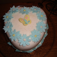 A Cake For A Special Couple Chocolate cake with fondant and gumpaste flowers.