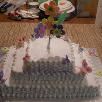 Simple Baby Shower 3 tiered sheet cakes, covered in buttercream, handmade fondant butterflies and flowers. :)