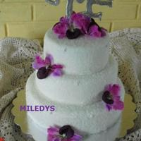 Wedding Cakes vanilla cake decorated in fondant and gum paste initials. silk flowers