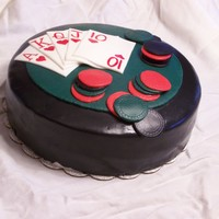 Poker Cake Devil's Chocolate cake, filled with chocolate mousse, frosted with Irish Cream flavored buttercream. Covered in fondant with fondant...