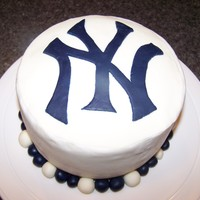 Yankee Cake Yankee logo cake. WASC with chocolate mousse filling and buttercream. Accents in fondant.
