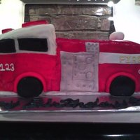 Fire Truck  Three layer homemade white cake w/ buttercream icing, covered w/ MMF. Detales all out of MMF, everything is hand painted with some silver...