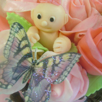 """anne Geddes"" Style Baby Shower Cake Cake topper is all white chocolate and marshmallow fondant except for wafer paper butterfly. Buttercream covered cake decorated with..."