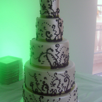 Funky Five Tier Wedding Cake Pearlized marshmallow fondant over dark chocolate cake with black royal icing