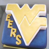 West Virginia University Marshmallow fondant covered cake with 3-D WVU logo sculpted from rice crispy cereal treats covered in white chocolate, then covered in...