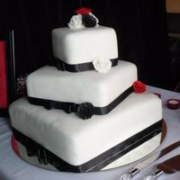 Square Wedding Cake  square cake offset for my friends wedding...this was my first square. had problems with the first round of fondant and it pulled the...