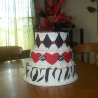 Casino Theme Party With A Little Bit Of Zebra .. = ) Vanilla Cake with Coconut Buttercream.. all icing except for the accents and feathers.. Really fun cake to make.. liked that the party girl...