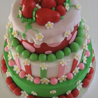Strawberry Short Cake Top - yellow cake with strawberry filling, Middle - vanilla with strawberry filling, bottom - Chocolate, with cheesecake mouse.Iced in...