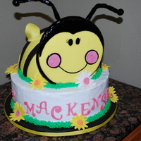 "Bumble Bee Bumble Bee & Daisy's to match party theme. This was for ""Golden"" birthday, 3 on 3rd. Bee was covered in Fondant and base..."