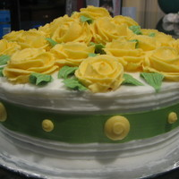 "Yellow Roses With Green Ribbon   8"" round cake with butter cream roses."