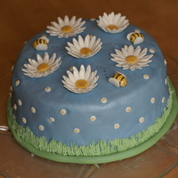 Dreaming Of Spring Was looking for an excuse to try out another cake...dinner with visiting family was a good one! I learned not to roll my fondant too thin...