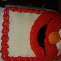 Elmo Birthday Cake   This cake was made for my little cousin birthday. Its a yello sheet cake, then I put the Elmo character pan on top.