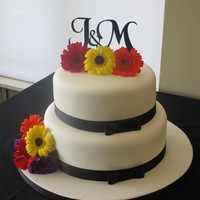 Monogram Wedding Cake white fondant covered 2 tier cake with fresh flowers and custome cut perspex topper