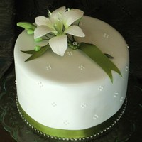 White & Green Lily Cake Double tier white chocolate & vanilla bean mudcake with sugar daylily. This was my 1st lily ever and it was actually made with orchid...