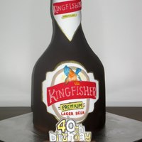 Kingfisher Beer Bottle Cake stacked mudcakes with chocolate fondant. Label is piped royal icing