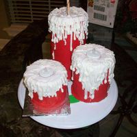 Candles  3 pillar candles I took 3 large cans and baked cake in then put drinking straws to support covered in fondant. cut top took battery...