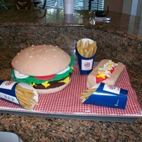 Hamburger French Fries,hot Dog  This is the first cake I have everdone!! It was so easy got some ideas from you guys so thanks! sons 24th b-day hamburger top was mixing...