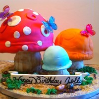Mushroom Cake strawberry cake sitting on top of rice crispy stems rocks are jellybeans