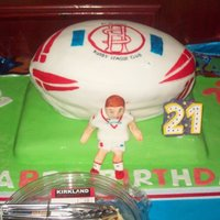 St. Helens Rugby Ball Birthday Cake made this as a present for my little cousin, first time ive had to transport a cake so far, was a scary journey over the M62 for his...