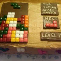 Tetris Tetris board made for grandmothers 78th birthday. Covered cake in brown buttercream. Used chocolate bars with square gum pieces glued on...