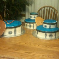 Drum Set Set of drums to match a drum set for my brothers senior recital. Various size cakes covered in fondant. Drum hardware is all fondant pieces...