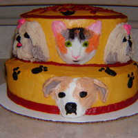 Salon De Pooch This is a layered red velvet cake with all buttercream frosting. I did you half marshmallows to give form for the snouts.