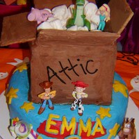 "Toy Story 3 For Emma The bottom is a layered 10"" white cake. The box is a layered chocolate cake covered with chocolate coated graham crackers for the..."