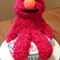 Elmo For Allie This is ALL cake with buttercream frosting. Gumballs for the eyes and a marshmallow for the nose covered in buttercream.
