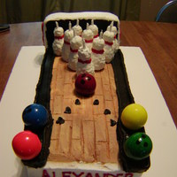 A Striking 10Th Birthday Marble cake with rkt bowling pins and large bubblegum ball bowling balls.