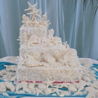 "Beach Themed Three tier square coconut cake. Pans used are 6, 10, &14. This is my first big cake! What a nerve racker to flip the 16""!! I used..."
