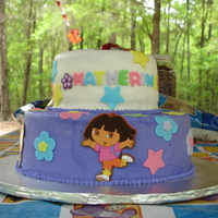 Dora Cake Dora cake for my daughter's 2nd birthday. She wanted a purple Dora cake. The top tier is covered in fondant and the bottom is...