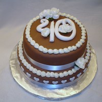 40Th Wedding Anniversary Cake   Moist Devils Food Cake layered with Chocolate Ganache Mousse, covered in brown fondant.
