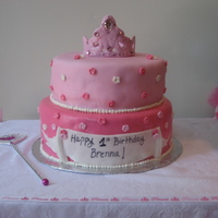 Tiara Birthday Cake This is a chocolate cake with chocolate mousse on the bottom and vanilla cake with raspberry filling on the top. The client wanted all pink...