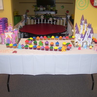 Castles And Candy  Triple birthday. Both castles are Disney princess themed and there are 4 dozen Candyland themed cupcakes set-up to mimic the game board. I...
