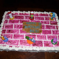 Handy Manny Cake  This is a Handy Manny cake for a three year old boys birthday. It is a half sheet with cream cheese buttercream. Bricks we painted with...