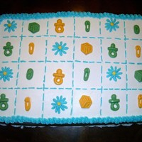 Baby Blanket Cake This is two half sheets stacked with strawberry filling and a baby blanket motif with molded baby blocks, shoes, pacifiers, diaper pins and...