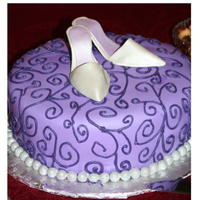 Purple Bridal Shoe Cake  I used the shoe template from http://cakecentral.com/articles/124/how-to-make-a-gumpaste-shoe with her directions and template made this so...