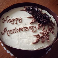 Anniversary Cake - Chocolate Hazelnut Mascaporne cream frosting, Chocolate Clay roses and wrapped in chocolate