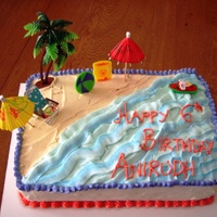Beach Cake All BC with plastic decorations. One of my first cakes!