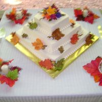 Autumn Wedding   Autumn leaves & bouquet. Buttercream icing with fondant leaves. Red Velvet cake.
