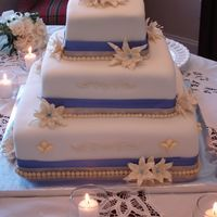 Wedding Lilies - May 2006 Wedding Lilies - Royal Icing Lilies & Leaves with Periwinkle Centers. Cream & periwinkle ribbon accents.
