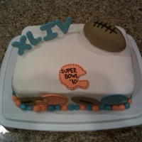 Superbowl Party Cake White cake with buttercream icing and MMF accents.
