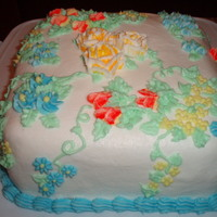 Flower Cake This cake was a trial run for me. I made it during my first Wilton class and it was my first time making any sort of flower/leaves. The...