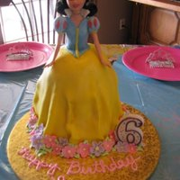 Snow White Snow White doll cake with buttercream and fondant.
