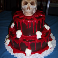 Death By Chocolate Chocolate cake with chocolate ganache filling and chocolate french buttercream frosting. Covered with modeling chocolate. Blood is red...