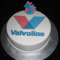 Valvoline Cake Made for my brother who has just started a new job with Valvoline.Rich fruit cake covered with white fondant. Details made in modelling...